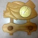 北海道アイヌ少女の温度計、ラック。