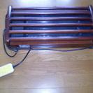 電気足暖器