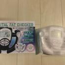 ハンディタイプのデジタル体脂肪測定器