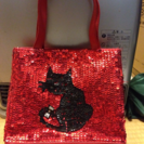 猫 スパンコールのバッグ