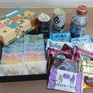 お土産のお菓子を野菜や米や日用品に交換してください。