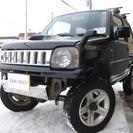 スズキ ジムニー 660 ワイルドウインド 4WD (ブラッ...