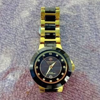 値下しました。腕時計J.HARRISON太陽電池の電波時計。