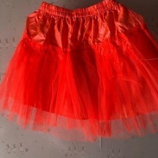 オレンジ色スカート