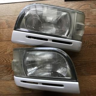 ミニキャブ バン ブラボー用純正異形ヘッドライト左右セット