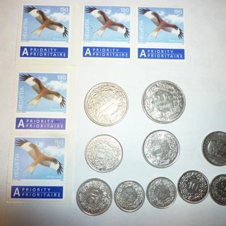 スイス未使用切手5枚とコイン6.5フラン(1700円強に相当)