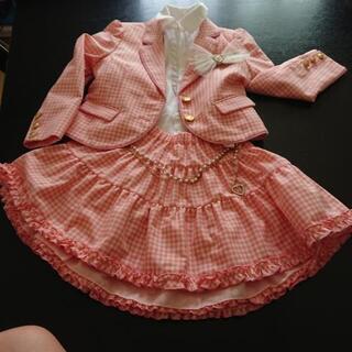 可愛いピンクのスーツ
