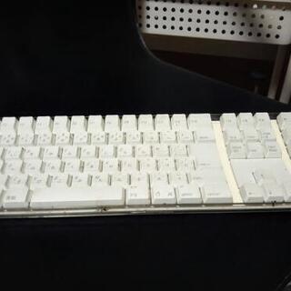 取引中 Macマックのキーボードの画像