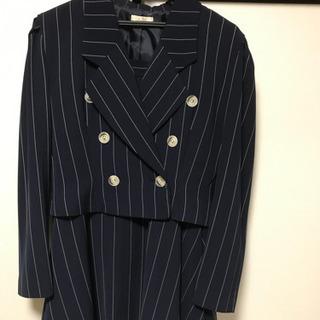 フレアスカートのスーツ