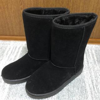 冬の黒いブーツ