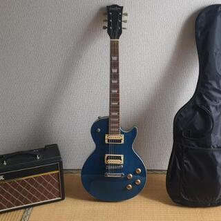 Les Paul風のエレキギターとvoxのアンプ