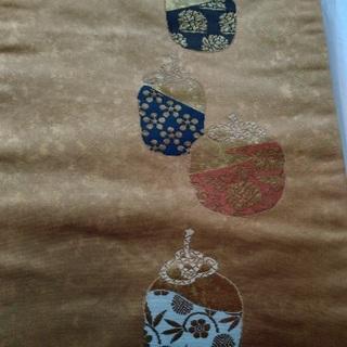 中古:正絹名古屋帯 金茶色 茶入れ仕覆柄
