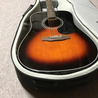 ほとんど未使用のアコースティックギター