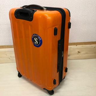 大きめ!鍵付きスーツケース☆オレンジ色☆ステッカーが貼って…