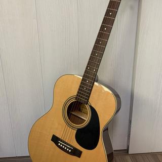 ほぼ新品のアコースティックギターです。