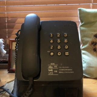 グレーの公衆電話