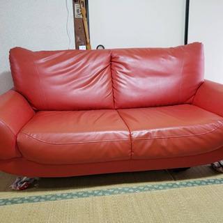 赤いソファーあげます