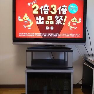 TV台(①開き戸棚、②回転台)