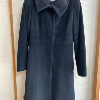 en quete 黒のコート