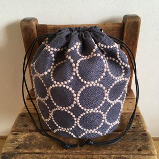 ミナペルホネンファブリック使用 タンバリンの丸底巾着バッグ