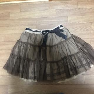 axes  femmeの茶色のスカート